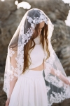 heirloom hand embroidered wedding veil in ivory with floral shapes and edging